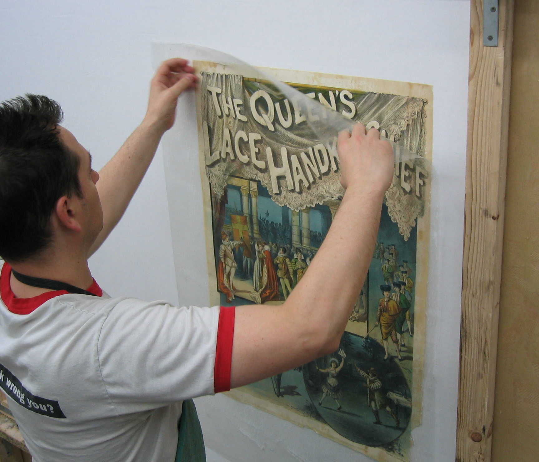 Poster conservation, linen backing and restoration by M & W Graphics, Inc in NYC NY restoration image